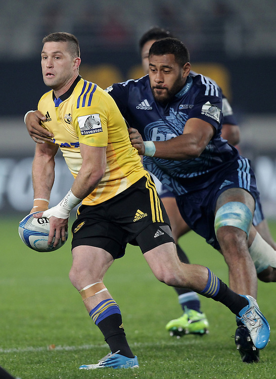 Hurricanes' Cory Jane is tackled by Blues' Patrick Tuipulotu in a Super Rugby match, Eden Park, Auckland, New Zealand, Saturday, May 31, 2014.  Credit:SNPA / David Rowland