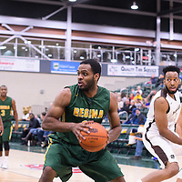 4th year forward Brian Ofori (11) of the Regina Cougars in action during the home game on January  14 at Centre for Kinesiology, Health and Sport. Credit: /Arthur Images