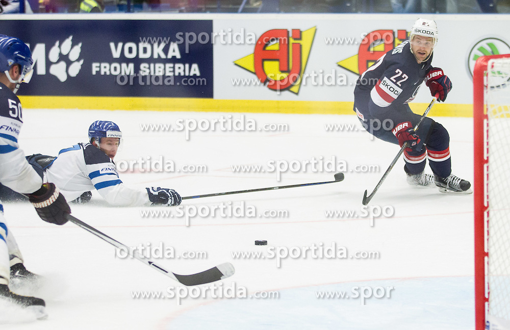 Juhamatti Aaltonen of Finland and Esa Lindell of Finland vs Trevor Lewis of USA during Ice Hockey match between USA and Finland at Day 1 in Group B of 2015 IIHF World Championship, on May 1, 2015 in CEZ Arena, Ostrava, Czech Republic. Photo by Vid Ponikvar / Sportida