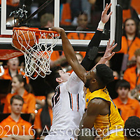 California's Jaylen Brown, right, dunks past Oregon State's Drew Eubanks in the second half of an NCAA college basketball game in Corvallis, Ore., on Saturday, Jan. 9, 2016. Oregon State won 77-71. (AP Photo/Timothy J. Gonzalez)