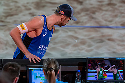 06-01-2019 NED: Dela Beach Open, Den Haag<br /> Netherlands lost the bronze medal from Russia 1-2 /  Alexander Brouwer #1 is furious on the referee after the stolen ball of Ilya Leshukov #1 and shoot the ball  against the ceiling.