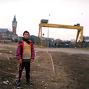 An Afghan refugee on industrial wasteland in Calais, France. The young man is waiting to try and seek asylum in the UK..After the Sangatte refugee camp closed down an average of 200 refugees lived on the streets of Calais, without food, money or accommodation, trying most nights to get to Britain.  There were many different nationalities, mainly Iraqi and Afghani, but also Sudanese, Palestinian and Turkish. 95% are male, aged between 16 and 50.