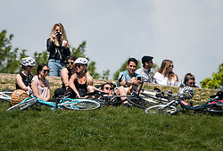 © Licensed to London News Pictures. 02/05/2020. London, UK. People gather on Primrose Hill in North London, during a pandemic outbreak of the COVID-19 strain of Coronavirus. According to government, the UK provided more than 122,000 coronavirus tests on the last day of April. Photo credit: Ben Cawthra/LNP