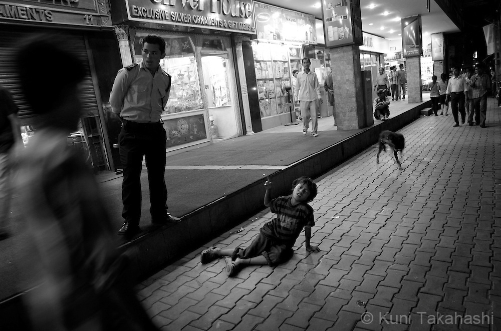 A street child collapses after being intoxicated by glue in Kathmandu, Nepal, on May 2010.<br /> Photo by Kuni Takahashi