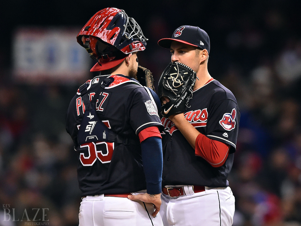 Oct 26, 2016; Cleveland, OH, USA; Cleveland Indians starting pitcher Trevor Bauer (right) talks with catcher Roberto Perez (55) in the third inning against the Chicago Cubs in game two of the 2016 World Series at Progressive Field. Mandatory Credit: Ken Blaze-USA TODAY Sports