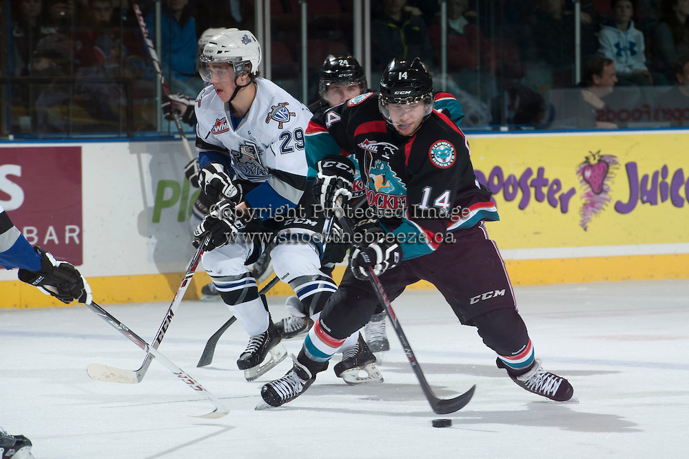 KELOWNA, CANADA - NOVEMBER 20: Rourke Chartier #14 of the Kelowna Rockets handles the puck against the Victoria Royals on November 20, 2013 at Prospera Place in Kelowna, British Columbia, Canada.   (Photo by Marissa Baecker/Shoot the Breeze)  ***  Local Caption  ***