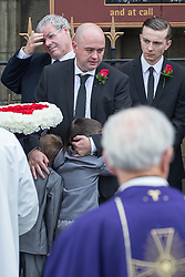 © Licensed to London News Pictures . 20/09/2014 . Manchester , UK . Mourners outside the cathedral after the service . Departures at the funeral of Heywood and Middleton MP Jim Dobbin at Salford Cathedral today (Saturday 20th September 2014) . Photo credit : Joel Goodman/LNP