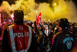 Anti-Terror Proteste in Istanbul - Fussballfans marschieren zum Stadion / 121216<br /> <br /> *** Turkish police watch soccer fans marching under heavy rain to protest Saturday's twin terror attacks as they march toward a soccer stadium in Istanbul, Monday, December 12, 2016.  Nearly 44 people, mostly police officers lost their lives after twin bomb attacks outside the stadium in Istanbul Saturday night following a soccer game.  ***