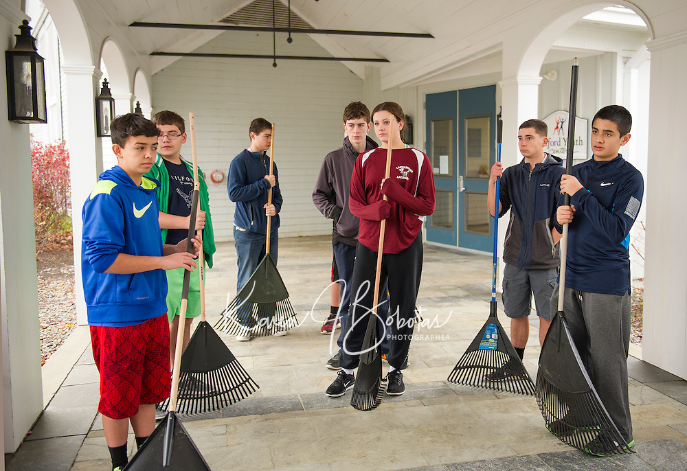 Gilford High School Freshmen gather at the Gilford Community Center to do some fall cleanup as part of the Gilford/Gilmanton Community Service Day on Tuesday.  (Karen Bobotas/for the Laconia Daily Sun)