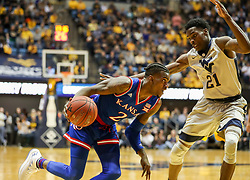 Jan 15, 2018; Morgantown, WV, USA; Kansas Jayhawks guard Lagerald Vick (2) drives baseline while guarded by West Virginia Mountaineers forward Wesley Harris (21) during the first half at WVU Coliseum. Mandatory Credit: Ben Queen-USA TODAY Sports