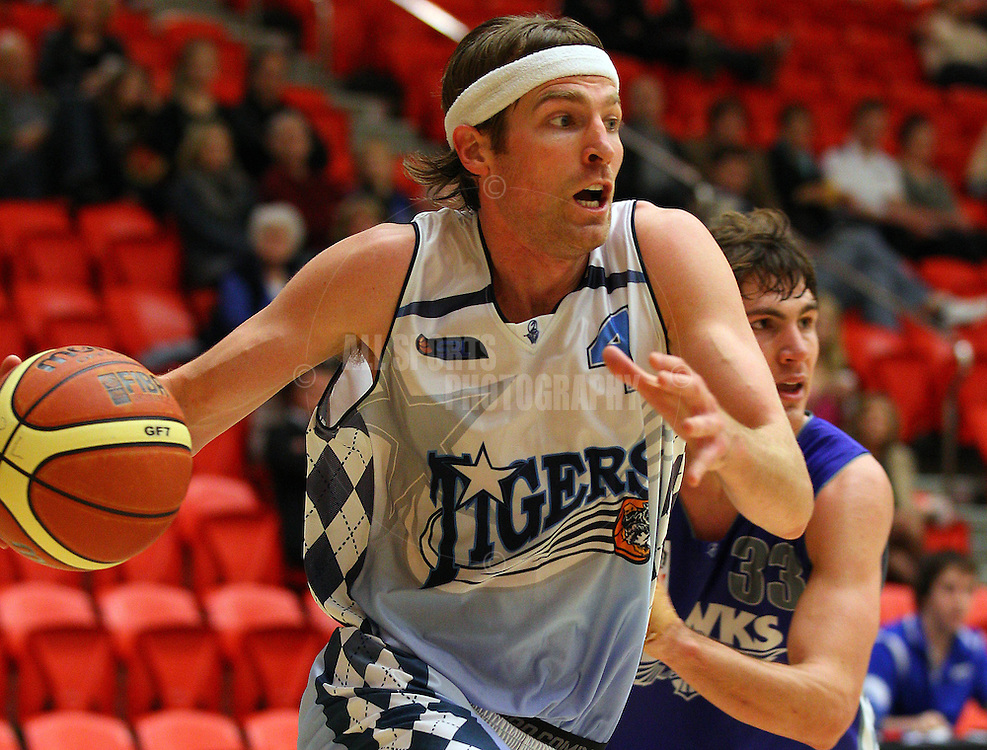 PERTH, AUSTRALIA - JULY 16: Rob Kampman of the Tigers drives to the basket during the week 18 SBL game between the Perry Lakes Hawks and the Willetton TIgers at The State Basketball Center on July 16, 2011 in Perth, Australia.  (Photo by Paul Kane/Allsports Photography)