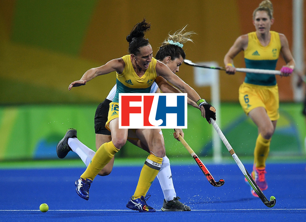 Australia's Madonna Blyth (front) and Argentina's Agustina Albertarrio collide during the women's field hockey Australia vs Argentina match of the Rio 2016 Olympics Games at the Olympic Hockey Centre in Rio de Janeiro on August, 11 2016. / AFP / MANAN VATSYAYANA        (Photo credit should read MANAN VATSYAYANA/AFP/Getty Images)
