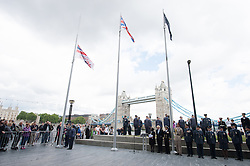 © London News Pictures. 22/06/15. London, UK. An Armed Forces Day flag is raised during a ceremony to honour UK Armed Forces, Central London. Photo credit: Laura Lean/LNP