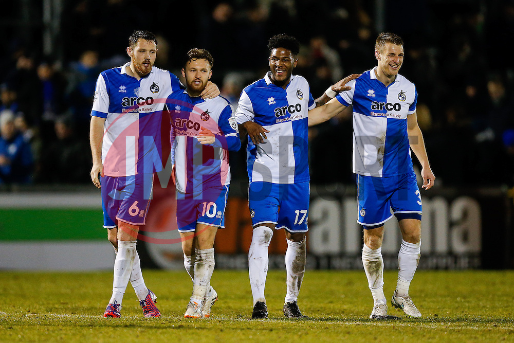 (L-R) Tom Parkes, Goalscorers Matt Taylor and Ellis Harrison, and Lee Brown celebrate after Bristol Rovers win the match to go 2 points clear at the top of the league - Photo mandatory by-line: Rogan Thomson/JMP - 07966 386802 - 24/02/2015 - SPORT - FOOTBALL - Bristol, England - Memorial Stadium - Bristol Rovers v Braintree Town - Vanarama Conference Premier.