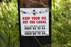 Sign warning to keep oil off the canal