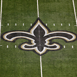 January 7, 2012; New Orleans, LA, USA; A detail of the New Orleans Saints fleur de lis logo at midfield for the 2011 NFC wild card playoff game against the Detroit Lions at the Mercedes-Benz Superdome. Mandatory Credit: Derick E. Hingle-US PRESSWIRE