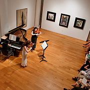 June 1, 2011 - New York, NY : From left to right, Frederic Chiu plays piano as Jennifer and Angela Chun perform on violin during 'Ballad and Dance' at the Tenri Cultural Institute on Wednesday evening, June 1...Karsten Moran for The New York Times