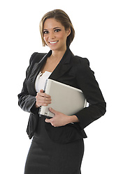 Young, pretty professional woman standing in front of a white background holding a laptop