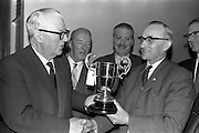 21/03/1963<br /> 03/21/1963<br /> 21 March 1963<br /> Irish National Insurance Company, South Frederick Street, Dublin. Presentations of trophies.