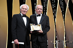 Jean-Pierre Dardenne and Luc Dardenne receive the Best Director Award for their film Le Jeune Ahmed at the Closing Ceremony during the 72nd annual Cannes Film Festival on May 25, 2019 in Cannes, France. Photo by David Niviere/ABACAPRESS.COM