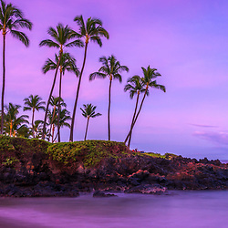 Maui Hawaii Ulua Beach shoreline colorful blue and purple morning sunrise panorama photo. Ulua Beach is a popular spot in Wailea Makena Hawaii along the Pacific Ocean. Copyright ⓒ 2019 Paul Velgos with All Rights Reserved.