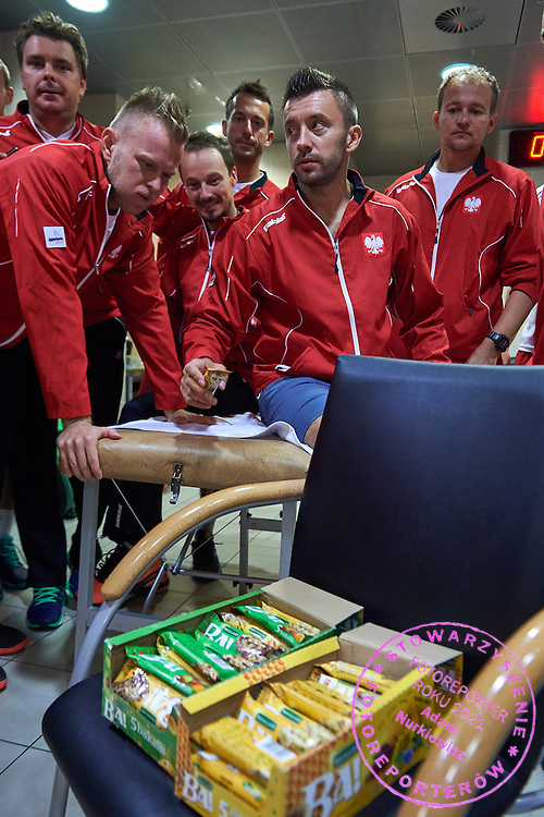 (L-R) Marcin Matkowski and Grzegorz Panfil and Radoslaw Szymanik - captain national team and trainer assistant Aleksander Charpantidis and Michal Przysiezny and Tomasz Tolstyko all from Poland with Bakalland snacks during Davis Cup Tie World Group Play-off Poland v Slovakia at Gdynia Arena Hall in Gdynia, Poland.<br /> <br /> Poland, Gdynia, September 20, 2015<br /> <br /> Picture also available in RAW (NEF) or TIFF format on special request.<br /> <br /> For editorial use only. Any commercial or promotional use requires permission.<br /> <br /> Adam Nurkiewicz declares that he has no rights to the image of people at the photographs of his authorship.<br /> <br /> Mandatory credit:<br /> Photo by &copy; Adam Nurkiewicz / Mediasport