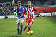 Accrington Stanley Sean McConville wins the ball of Carlisle Striker Shaun Miller during the EFL Sky Bet League 2 match between Accrington Stanley and Carlisle United at the Fraser Eagle Stadium, Accrington, England on 21 January 2017. Photo by Pete Burns.