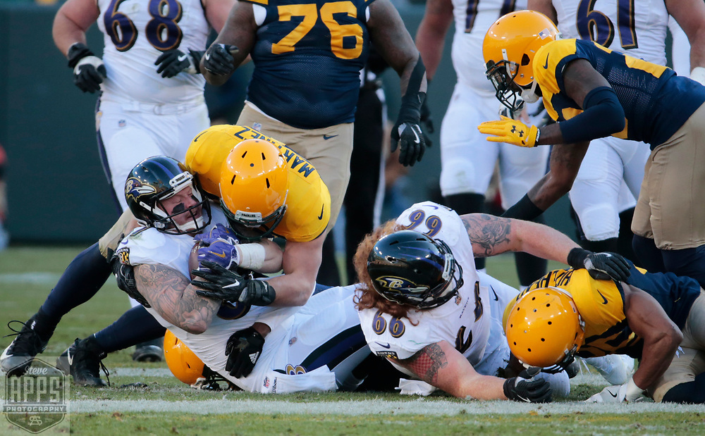 Green Bay Packers inside linebacker Blake Martinez (50) brings down Baltimore Ravens tight end Maxx Williams (87) after a short gain in the 4th quarter. <br /> The Green Bay Packers hosted the Baltimore Ravens at Lambeau Field Sunday, Nov. 19, 2017. The Packers lost 23-0. STEVE APPS FOR THE STATE JOURNAL.