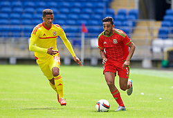 CARDIFF, WALES - Friday, June 5, 2015: Wales' Neil Taylor and Tyler Roberts during a practice match at the Cardiff City Stadium ahead of the UEFA Euro 2016 Qualifying Round Group B match against Belgium. (Pic by David Rawcliffe/Propaganda)