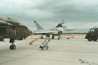06 JUN 2000, BERLIN/GERMANY:<br /> EUROFIGHTER EF 2000 (Mitte), zukünftiges Jagdflugzeug der Bundesluftwaffe, und TORNADO (links vorn), Mehrzweckkampfflugzeug der Bundesluftwaffe, Internationale Luftfahrausstellung, ILA 2000 <br /> IMAGE: 20000606-01/04-11<br /> KEYWORDS: Flugzeug, plane, Armee, army, Bundeswehr, Waffe, wappon