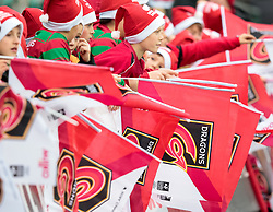 Dragons supporters wave flags before the match<br /> <br /> Photographer Simon King/Replay Images<br /> <br /> Guinness Pro14 Round 11 - Dragons v Cardiff Blues - Tuesday 26th December 2017 - Rodney Parade - Newport<br /> <br /> World Copyright © 2017 Replay Images. All rights reserved. info@replayimages.co.uk - www.replayimages.co.uk
