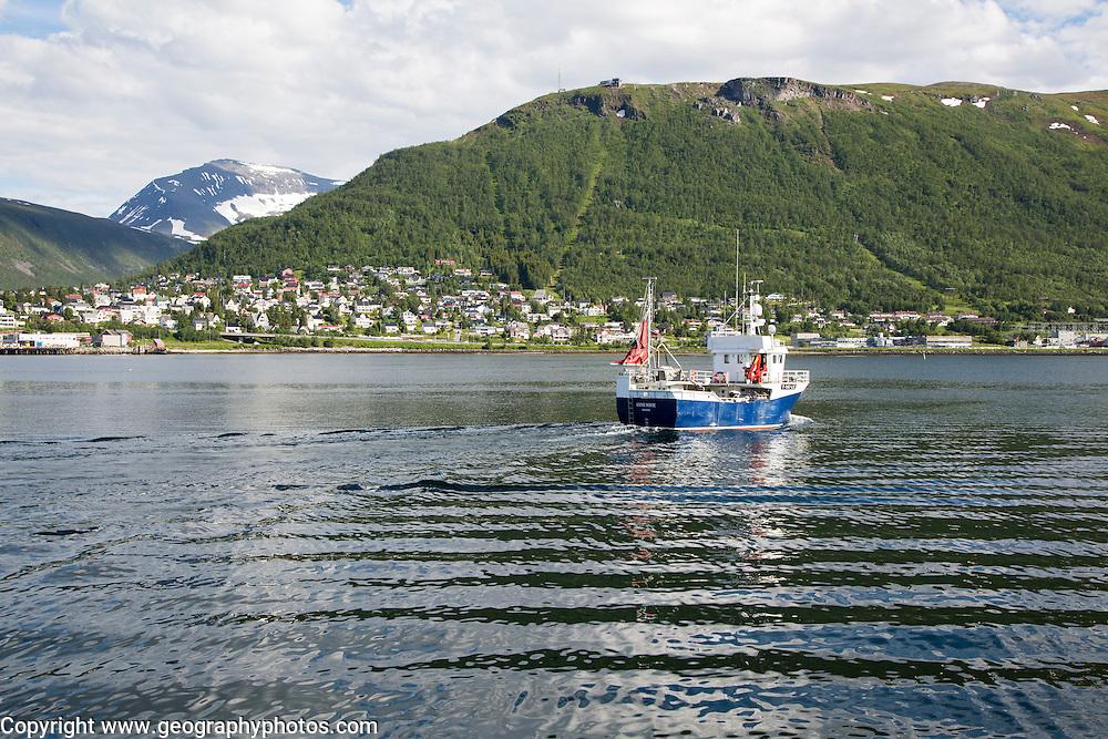 Fishing boat leaving port at Tromso, Norway