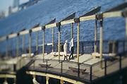 Two people walking on a pier