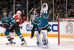 April 29, 2010; San Jose, CA, USA; San Jose Sharks goaltender Evgeni Nabokov (20) makes a glove save during the third period in game one of the western conference semifinals of the 2010 Stanley Cup Playoffs against the Detroit Red Wings at HP Pavilion. The Sharks defeated the Red Wings 4-3. Mandatory Credit: Jason O. Watson / US PRESSWIRE