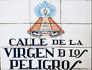 Ceramic street sign in Madrid, Spain Calle de la Virgen de los Peligros
