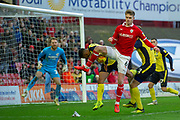Barnsley defender Liam Lindsay (6) back heels the ball during the EFL Sky Bet League 1 match between Barnsley and Scunthorpe United at Oakwell, Barnsley, England on 2 February 2019.