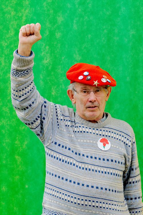 Comunnist militant holding high his left fist