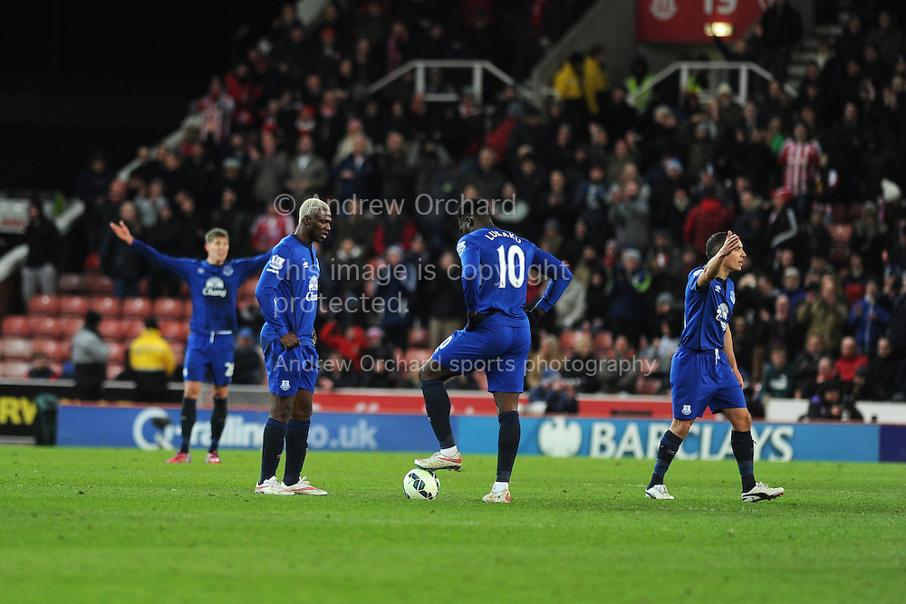 Everton players look on dejected as they prepare to restart after going 2-0 down. Barclays Premier League match, Stoke city v Everton at the Britannia Stadium in Stoke on Trent , Staffs on Wed 4th March 2015.<br /> pic by Andrew Orchard, Andrew Orchard sports photography.