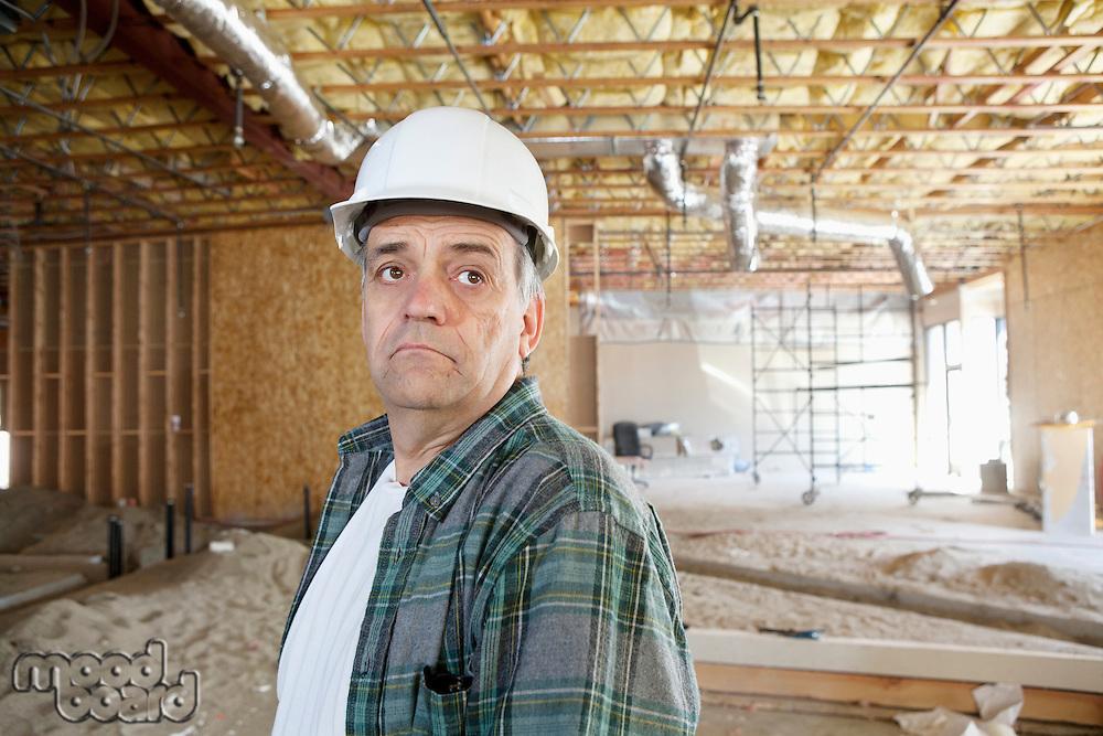 Contractor wearing hardhat looking away