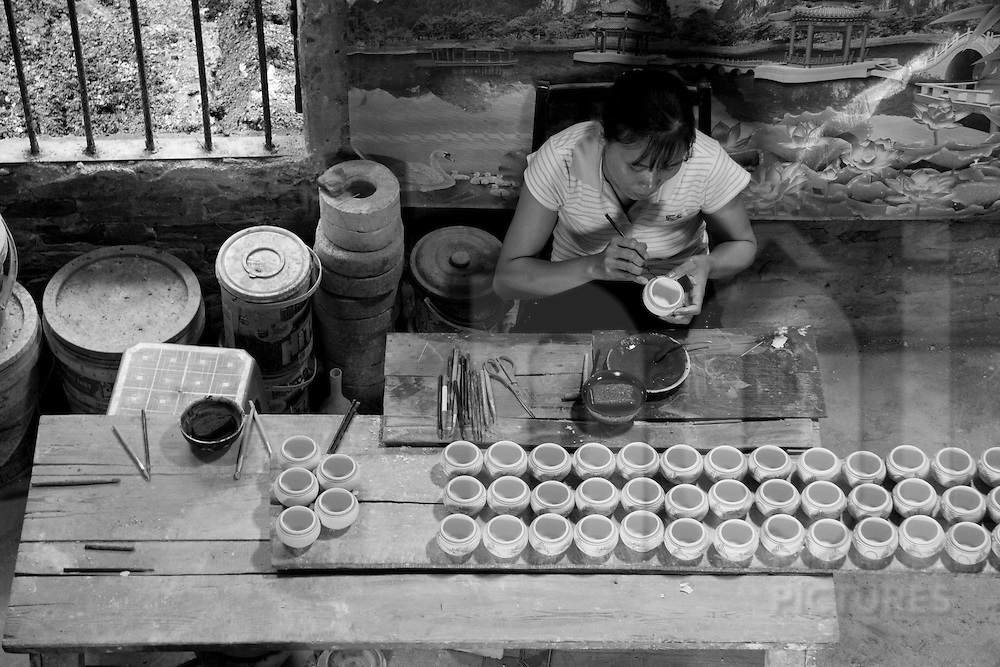 Handicraft pottery village of Bat Trang. Bát Tràng (literally: bát is bowl and tràng is workshop) is an old, well established village in the Gia Lâm district of Hanoi, the capital city of Vietnam. It is about 13 km from central Hanoi...It is famous for producing a unique style of ceramics called Bát Tràng Porcelain. Bát Tràng is well known throughout Vietnam for its beautiful ceramics.