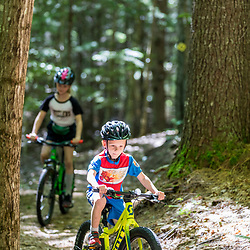 A boy and his sister ride mountain bikes at the Shepards Farms Preserve in Norway, Maine.
