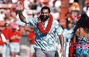 Former Pittsburgh Steelers running back Franco Harris waves to fans as he is introduced as a recently announced member of the Pro Football Hall of Fame at halftime during the 1990 NFL Pro Bowl between the National Football Conference and the American Football Conference on Feb. 4, 1990 in Honolulu. The NFC won the game 27-21. (©Paul Anthony Spinelli)