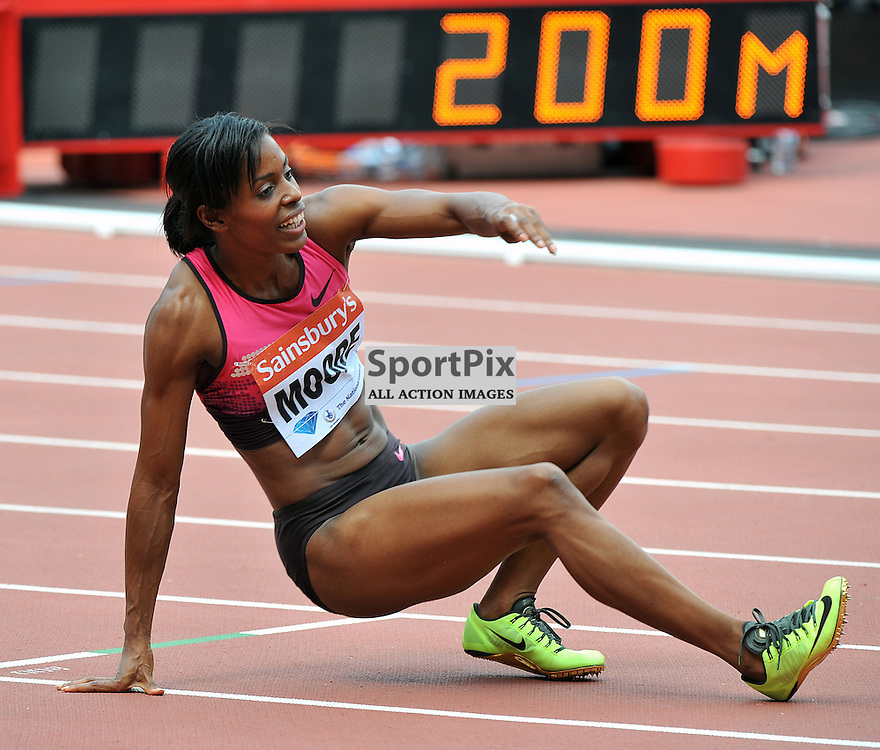Lashauntes Moore having a sit down after the 200m Final.<br /> At the IAAF Diamond League - Sainsbury's Anniversary Games held at the London Olympic Stadium, Queen Elizabeth Olympic Park, Stratford, London, UK on the 27th July 2013.<br /> WAYNE NEAL | SPORTPIX.ORG.UK