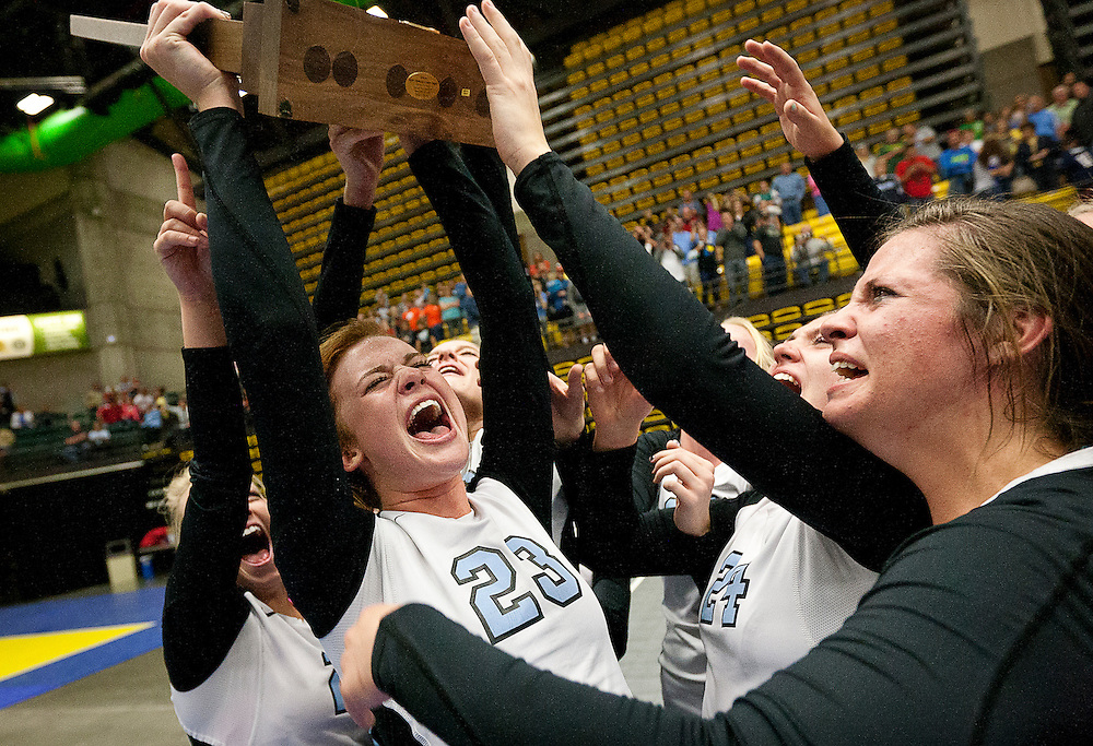 Sky View's Maddie Day (23) proudly holds up the 1st place trophy after winning the Utah State High School Volleyball 4A championship match between Sky View and Timpview in the UCCU in Orem, Saturday, Nov. 3, 2012.