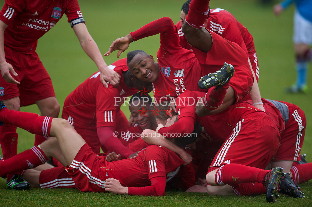 KIRKBY, ENGLAND - Saturday, February 5, 2011: Liverpool's Adam Morgan is mobbed by team-mates as he celebrates scoring the second goal against Manchester City during the FA Academy Under 18s League at the Kirkby Academy. (Photo by David Rawcliffe/Propaganda)
