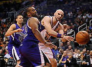 Dec. 17, 2012; Phoenix, AZ, USA; Phoenix Suns center Marcin Gortat (4) is guarded by the Sacramento Kings forward Chuck Hayes (42) in the second half at US Airways Center. The Suns defeated the Kings 101-90.  Mandatory Credit: Jennifer Stewart-USA TODAY Sports