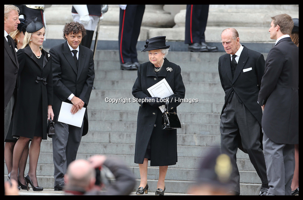 The Queen walks past the family of Baroness Thatcher at the end of the former Prime Minister's funeral at    St.Paul's Cathedral in London , Wednesday 17th  April 2013 Photo by: Stephen Lock / i-Images