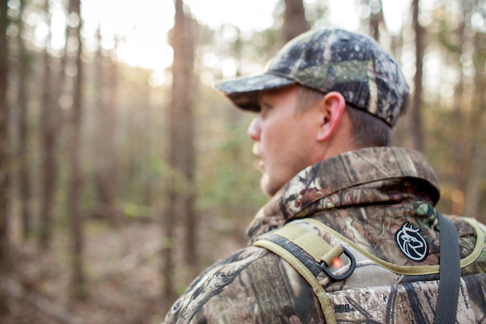 Lone hunter walking through woods listening for gobblers.