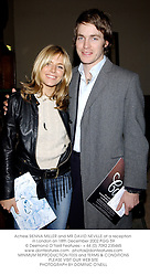 Actress SIENNA MILLER and MR DAVID NEVILLE at a reception in London on 18th December 2002.	PGG 59