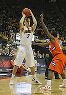 November 29, 2011: Iowa Hawkeyes guard Josh Oglesby (2) looks to pass during the first half of the NCAA basketball game between the Clemson Tigers and the Iowa Hawkeyes at Carver-Hawkeye Arena in Iowa City, Iowa on Tuesday, November 29, 2011. Clemson defeated Iowa 71-55 in the Big Ten-ACC Challenge game.